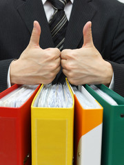 good accounting or business service with thumb up on binders
