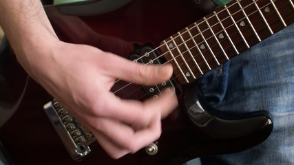 Close up shot of a man playing guitar