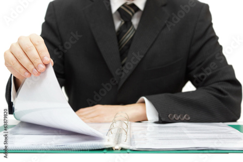 Inspection. Businessman reading binder with accounts