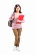 Teenage schoolgirl carrying backpack