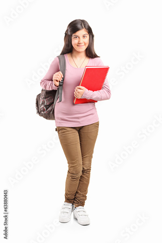 Teenage schoolgirl carrying backpack