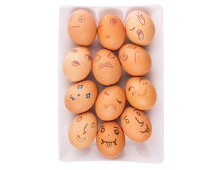Drawn face expressions on chicken eggs