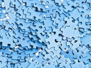pile of separated blue puzzle pieces