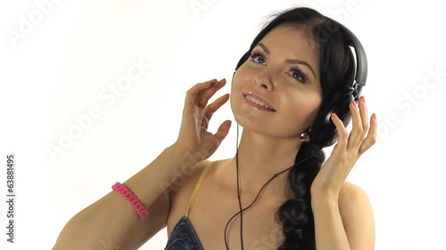 Music. Woman dancing with headphones listening to music on mp3