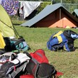 backpacks of hikers in the camping tents