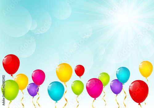 Color balloons on sunny background