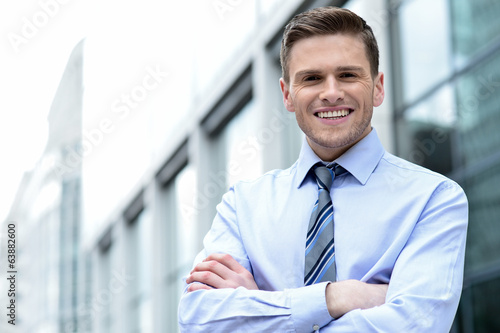 Young corporate man posing confidently