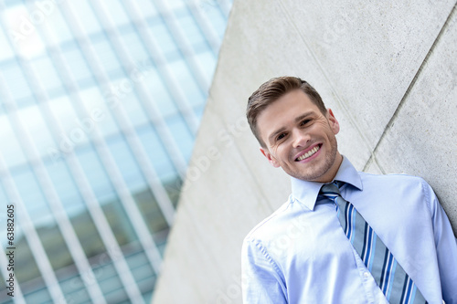 Young business executive posing outdoors