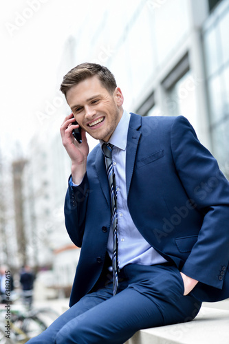 Smart businessman talking in his mobile phone