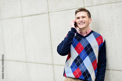 Casual guy talking on a cell phone
