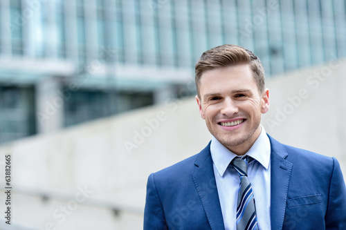 Attractive businessman standing at outdoors