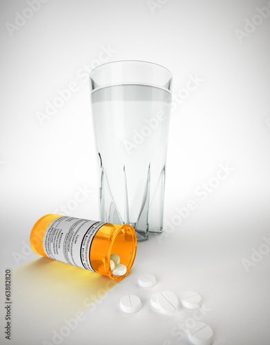 Yellow medicine jar and pills lying on floor with some pills out