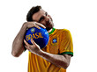 man Brazilian Brazil hugging soccer ball