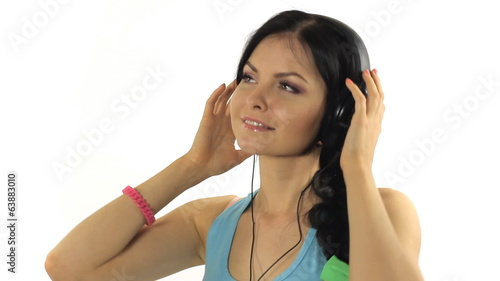 Beautiful Woman Listening Music and dancing Close-up