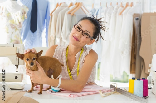 Beautiful female fashion designer with chihuahua