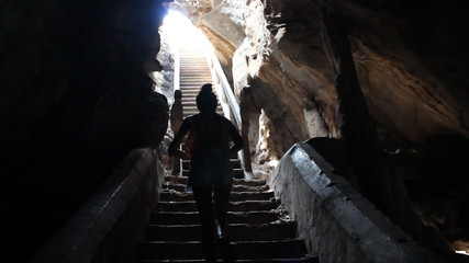 A girl climb up to the light of cave