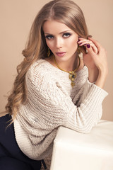 portrait of beautiful woman with blond hair in cardigan