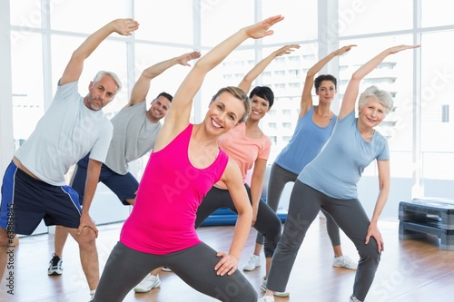 canvas print picture Class stretching hands at yoga class
