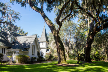 White Church Under Spanish Moss and Green Lawn