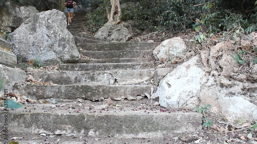 A girl climb on stairs to the top of mountain