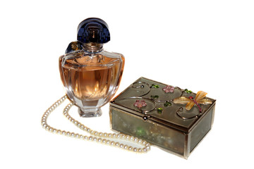 Perfume bottle, casket and a string of pearls