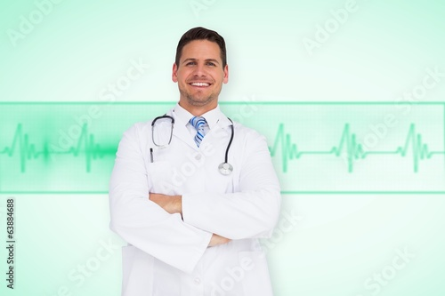 Composite image of handsome doctor with arms crossed