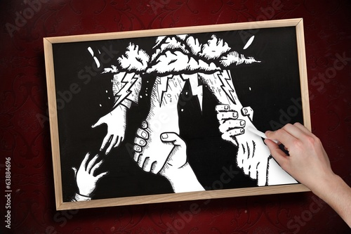 Composite image of hand drawing helping hands with chalk