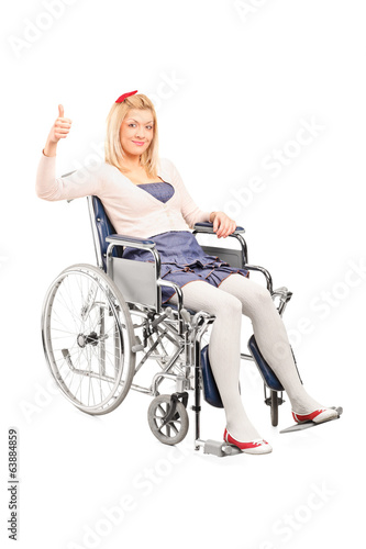 Disabled woman in a wheelchair giving thumb up