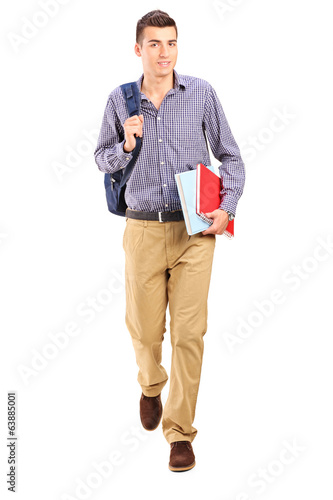 Male student walking with backpack