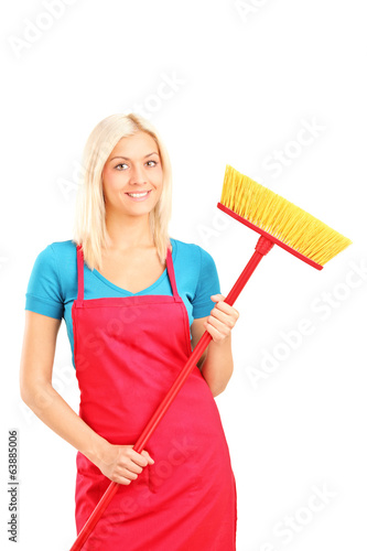 Female cleaner holding a broom