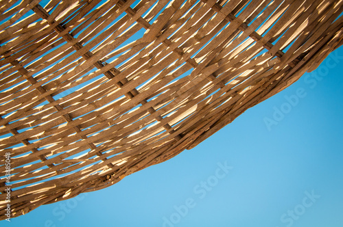 Background  rattan parasol of wicker