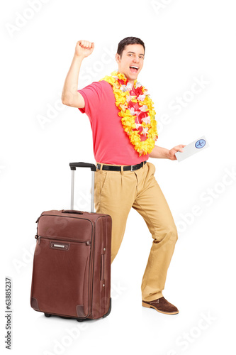 Man holding a plane ticket and gesturing happiness