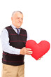 Mature man holding red heart