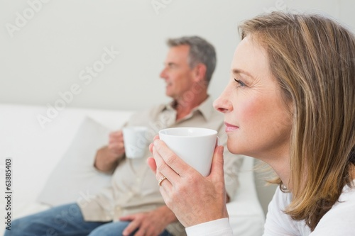 Relaxed couple with coffee cups