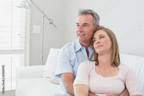 Relaxed couple embracing in the living room