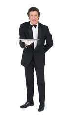 Portrait of waiter holding tray over white background