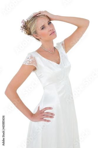 Sensuous bride posing against white background