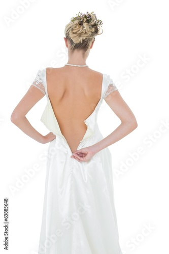 Rear view of bride getting dressed