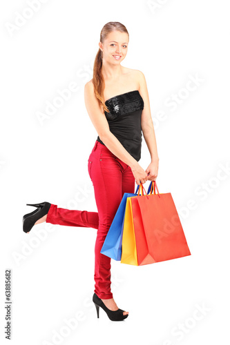 Young woman posing with shopping bags