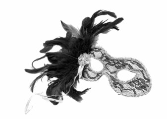 theatrical mask with black feathers
