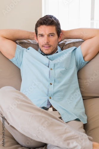 Portrait of a relaxed man sitting on couch