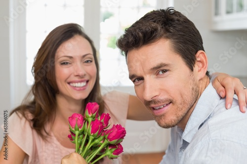 Close-up of a happy man and woman with flowers