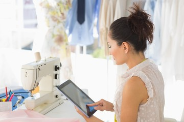 Female fashion designer using digital tablet