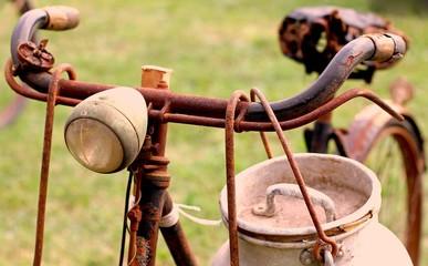 Rusty milkman's bike with drum