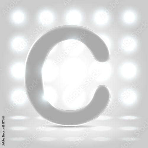C over lighted background