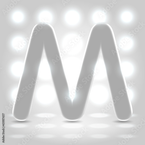 M over lighted background
