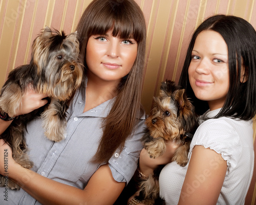 two girls with puppys