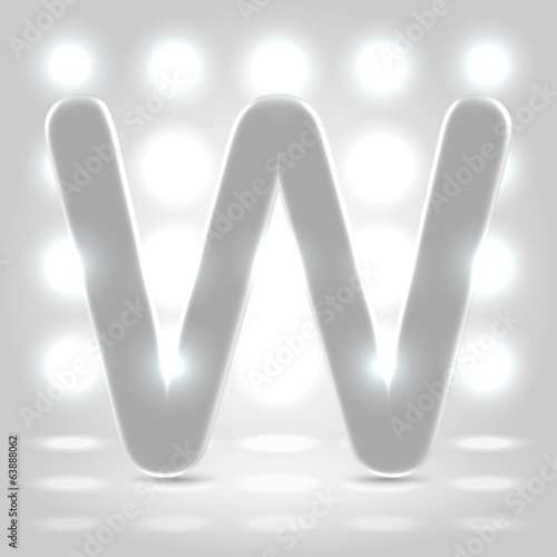 W over lighted background