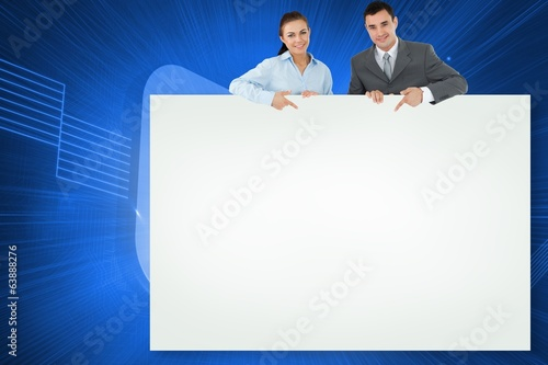 Composite image of business partners showing card