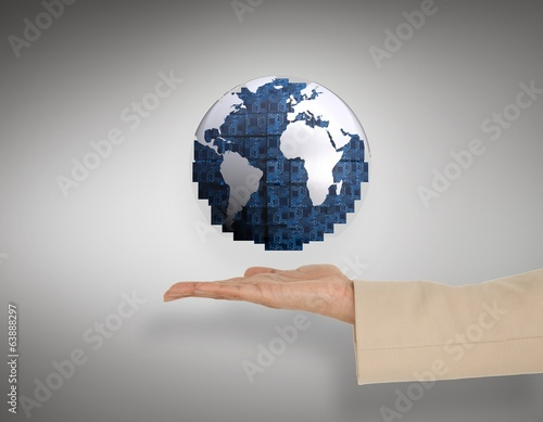 Composite image of female hand presenting blue earth